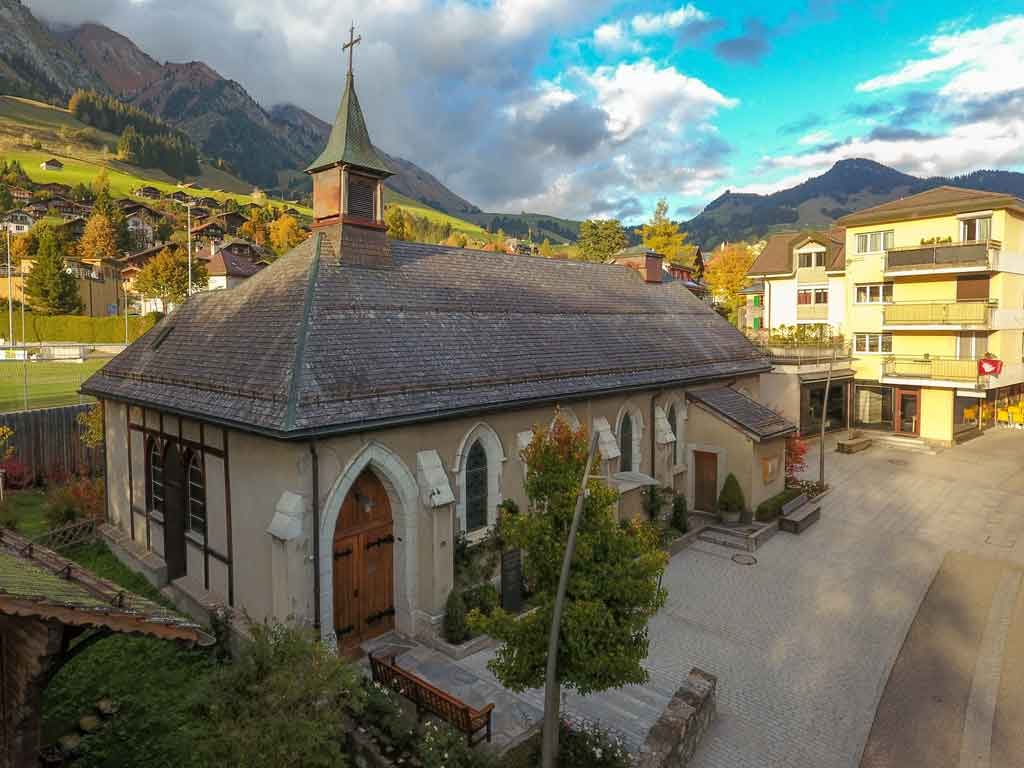Saint Peter's English Church (Anglican) serving Château d'Oex and Gstaad regions in Switzerland. Aerial view from Château d'Oex high street